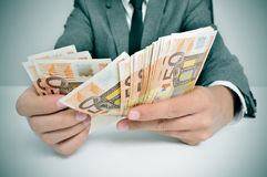 Man in suit with counting euro bills Royalty Free Stock Photos