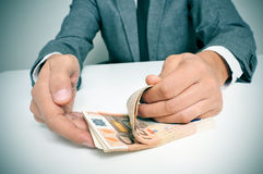 Man in suit counting euro bills Stock Image