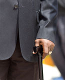 Man in suit with crutch Royalty Free Stock Photos