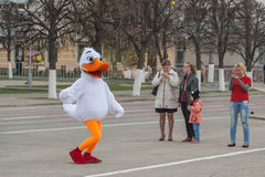 Man in suit dancing duck on the red square of Cheboksary, Chuvash Republic, Russia. May 1, 2016. Man in suit dancing duck on the red square of Cheboksary royalty free stock photography