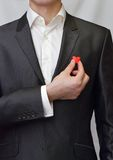 A man in a suit with a decorative heart in hand Royalty Free Stock Images