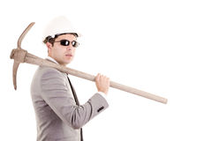 Man in suit displaying pick-axe Royalty Free Stock Image
