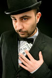 Man in suit with dollars Stock Photo