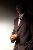 Man in suit with drink Royalty Free Stock Photography