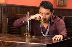 Man in suit drinking alcohol shot Royalty Free Stock Photos