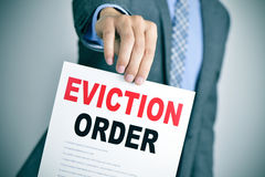 Man in suit with an eviction order Stock Image