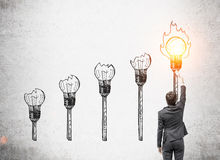 Man in suit firing torch Royalty Free Stock Photos
