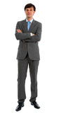 Man in Suit with Folded Arms. Young man in business suit with folded arms, isolated Royalty Free Stock Photos