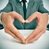 Man in suit forming a heart with his hands Stock Photography