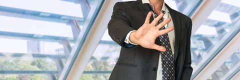 Man in suit gestures leave me alone Royalty Free Stock Image