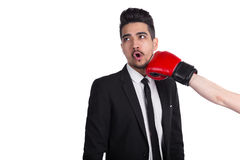 Man in suit gets hit from person in boxing gloves Stock Images