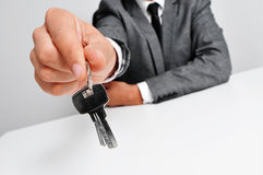 Man in suit giving the keys Royalty Free Stock Photo