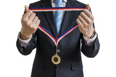 Man in suit is giving medal. Isolated on white background Royalty Free Stock Photos