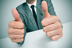 Man in suit giving a thumbs up signal Royalty Free Stock Image