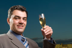 Man in a suit with a glass of champagne Royalty Free Stock Images
