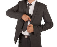 Man in a suit grabbing gun. A man in a suit grabbing a gun out his jacket isolated on white Royalty Free Stock Images