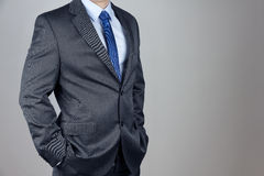 Man in suit. In gray background royalty free stock image