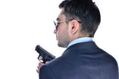 Man in  a suit with gun Stock Images
