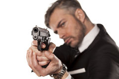 Man in a suit with a gun Royalty Free Stock Photography