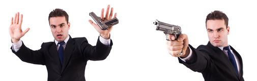The man in suit with gun isolated on white. Man in suit with gun isolated on white royalty free stock images
