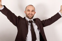 A man with suit is happy Royalty Free Stock Photography
