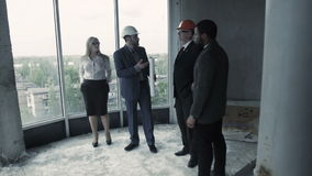 Man in suit, hard hat show woman, african american unfinished construction. Young couple, wife. And husband buy house, new home for extended family. Male stock video