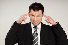 Man in suit has headache Royalty Free Stock Images