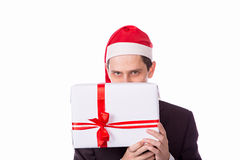 Man in suit and hat with Christmas gift hand on white backgro Royalty Free Stock Photography