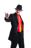 Man in suit and hat on white Stock Photos