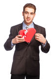 Man in suit with a heart-shaped gift Stock Photography