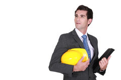 Man in a suit and helmet. With folder Stock Photography