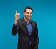 Man in suit with his finger up Stock Photos