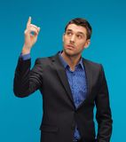 Man in suit with his finger up Stock Images