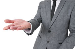 Man in suit with his hand open Royalty Free Stock Photography