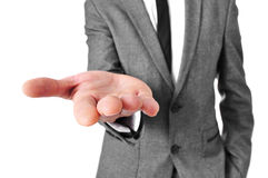 Man in suit with his hand open Royalty Free Stock Image