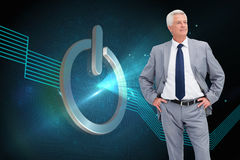 Man in a suit with his hands on his hips Royalty Free Stock Photos