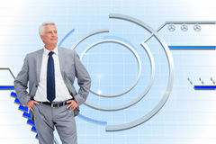 Man in a suit with his hands on his hips Royalty Free Stock Photo