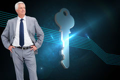 Man in a suit with his hands on his hips Stock Photos
