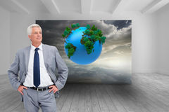 Man in a suit with his hands on his hips Royalty Free Stock Image