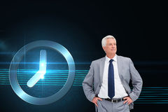 Man in a suit with his hands on his hips Stock Image