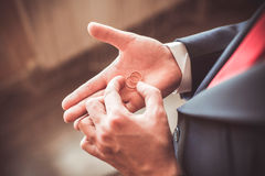A man in a suit with his wedding rings Stock Photos