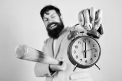 Man suit hold clock and baseball bat in hands. Business discipline concept. Time management and discipline. Discipline. And sanctions. Boss aggressive face hold royalty free stock photos