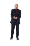 Man in suit holding. Buisness man in suit in a holding pose Stock Images