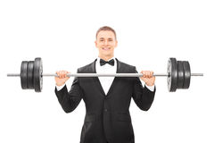 Man In suit holding a barbell. Isolated on white background Royalty Free Stock Image