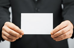 Man in suit holding blank card Royalty Free Stock Images