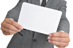 Man in suit holding a blank signboard Royalty Free Stock Photo