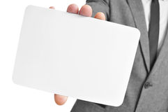 Man in suit holding a blank signboard Royalty Free Stock Photography