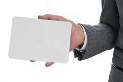 Man in suit holding a blank signboard Royalty Free Stock Image