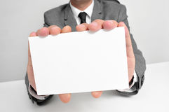 Man in suit holding a blank signboard Royalty Free Stock Images