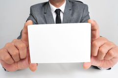 Man in suit holding a blank signboard Stock Photography